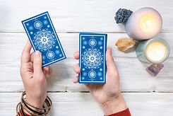 Tarot cards in fortune teller hand on wh