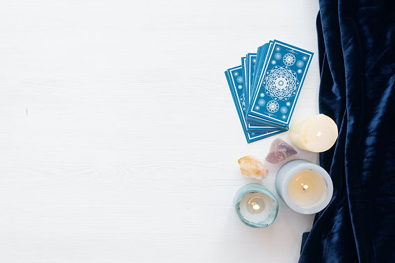 Tarot cards on the white wooden table ba
