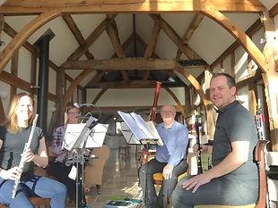 Cuillin sound musicians rehearsing in a barn