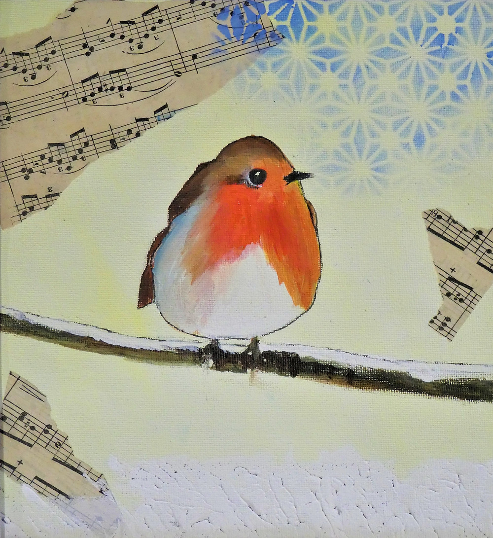 A redbreasted European Robin on a snowy branch. a light yellow background with some blue stencilling over collaged music score.