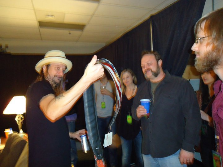 Kid Rock receiving his custom strap