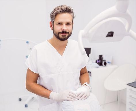 dentist-standing-clinic.jpg