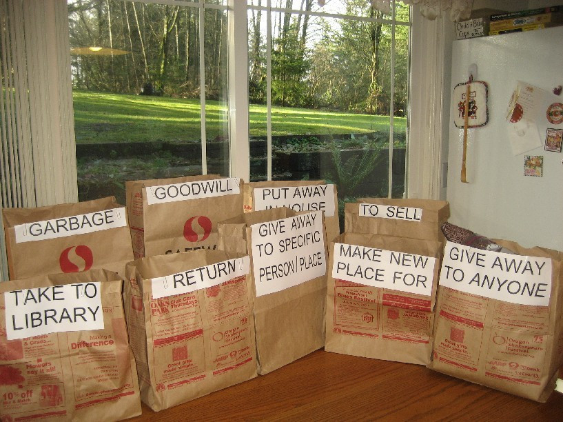 Sacks lined up on kitchen table / How to Organize a TOTAL MESS! / www.HoneycombOasis.com