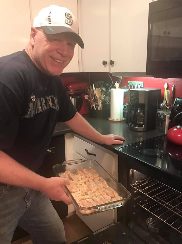 Dave putting the pan of fish into the oven / Man Bee Cookin' Broiled Fish / www.HoneycombOasis.com