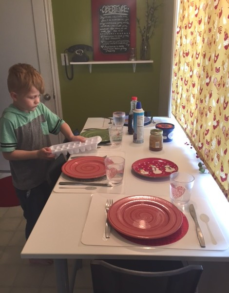 Weston setting the table - How to Make Training Placemats www.HoneycombOasis.com