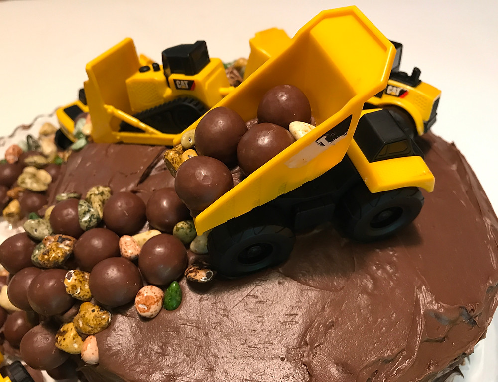 Dump truck dumping malted milk balls / Make a Construction Site Cake! / www.HoneycombOasis.com