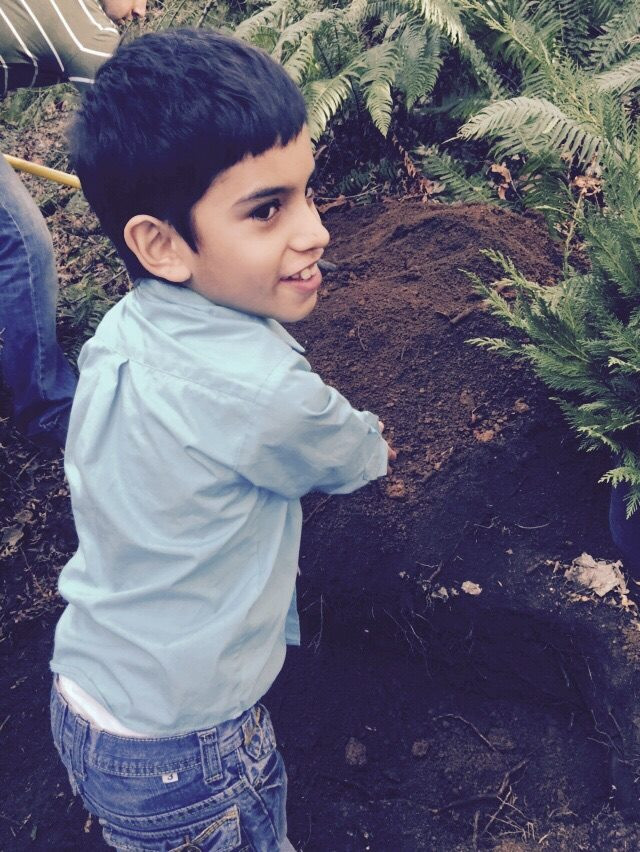 Jonah smiling by the mound / Memorial Service for a Beloved Cat / www.HoneycombOasis.com