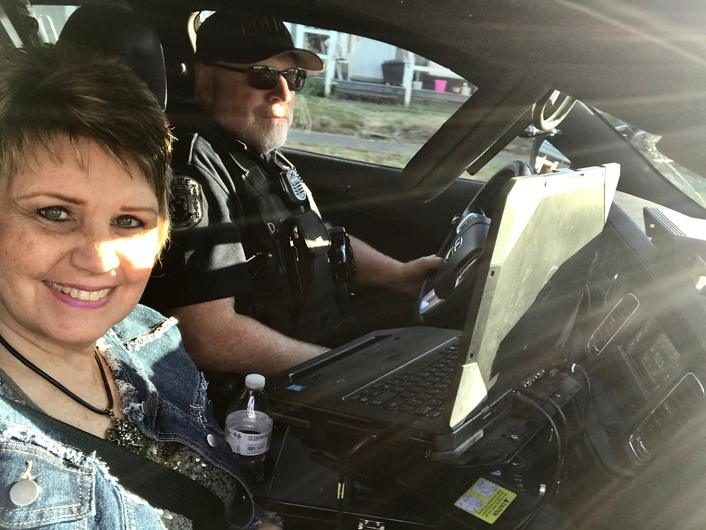 Barb riding with Dave in cop car on last day / Cop's Last Shift & Final Sign-off / HoneycombOasis.com
