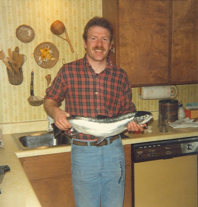 Much younger Dave holding a fish he'd caught / Man Bee Makin' Smoked Fish / www.HoneycombOasis.com