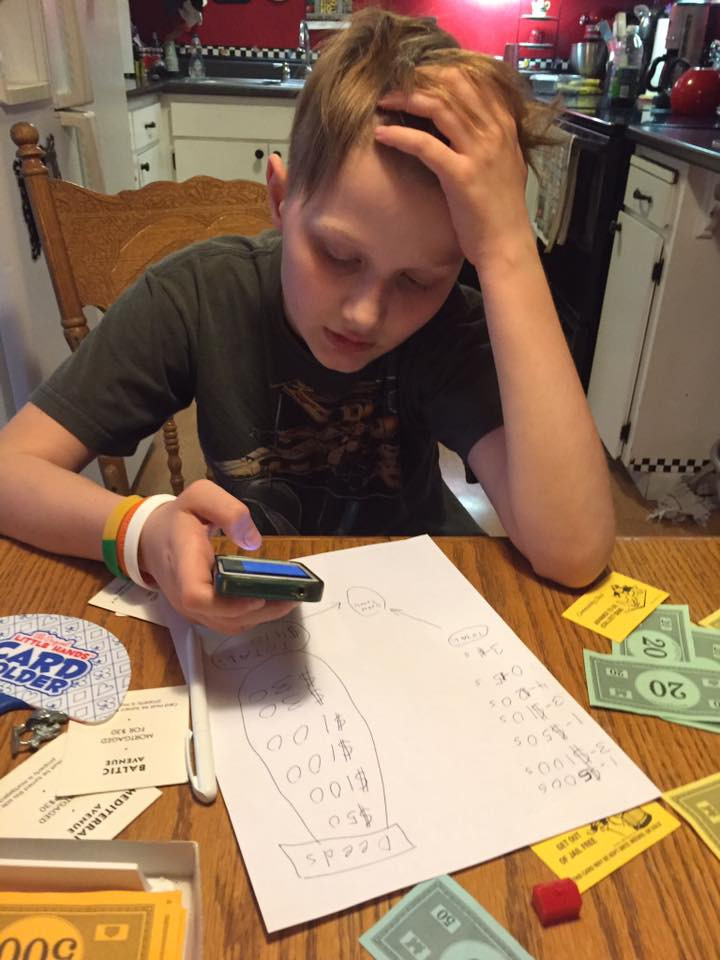 Chase calculating his final assets / My Most Rousing Game of Monopoly. EVER! / www.HoneycombOasis.com