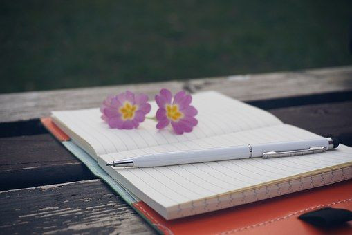 Open journal with pen and flowers / Commune With Me Guide / www.HoneycombOasis.com
