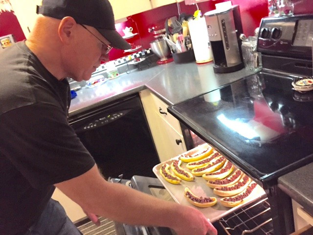 Dave putting bananas with chocolate chips under broiler / Banana Boats, Anyone?!? / www.HoneycombOasis.com
