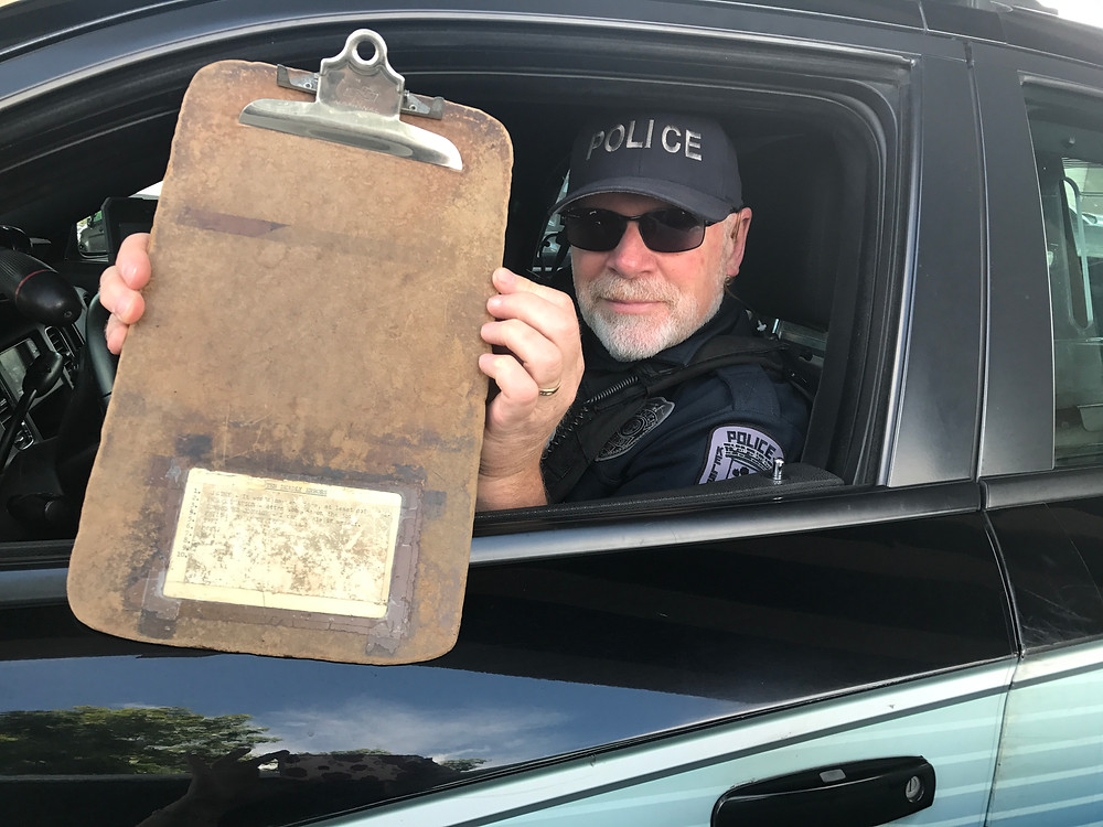 Dave holding up his dilapidated police clipboard / The Dilapidated Police Clipboard / www.HoneycombOasis.com