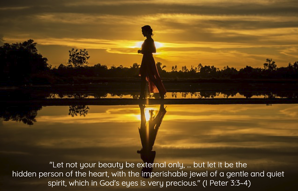 Woman walking along lake with golden sky - In Pursuit of True Beauty - www.HoneycombOasis.com