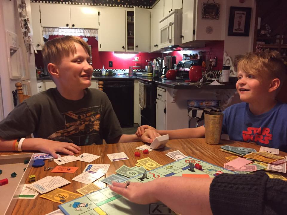 Chase and Weston touching hands & smiling / My Most Rousing Game of Monopoly. EVER! / www.HoneycombOasis.com