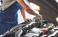 auto-mechanic-working-in-garage-repair-s