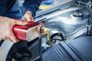 mechanic-changing-engine-oil-on-car-vehi