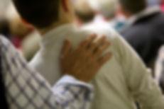 Hand on shoulder.jpg