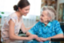 Senior woman with her caregiver at home.