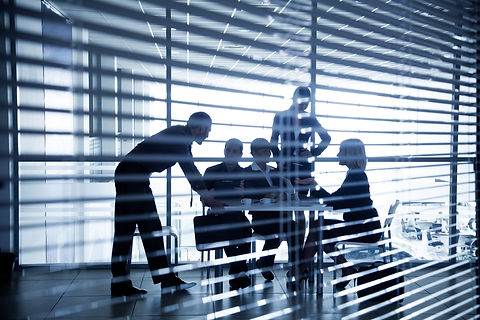 Several silhouettes of businesspeople in