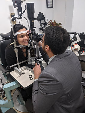 Dr. Neil Satija, Optometrist giving a medical eye examination
