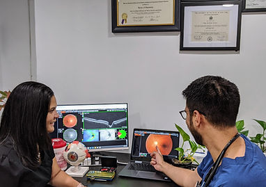 Dr. Satija showing a retinal photo and OCT scan