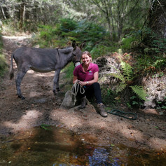 Host with donkey at Le Moulin de Pensol.