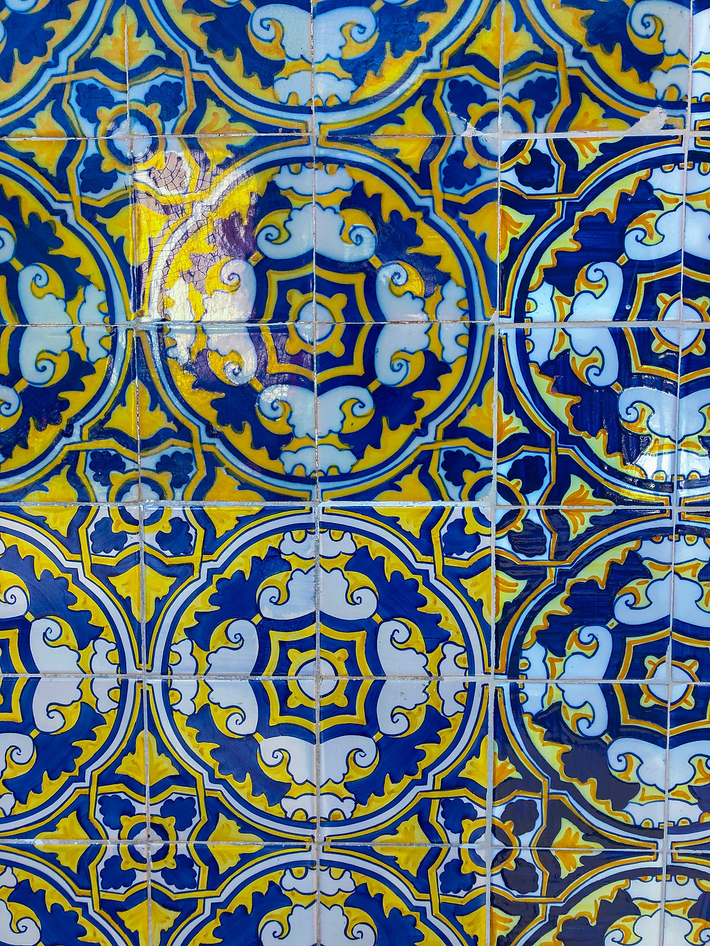 photograph of girl fashion travel blogger in fun boating outfit exploring downtown city center of Old Town Cascais Portugal, admiring the handpainted Portuguese tiles.
