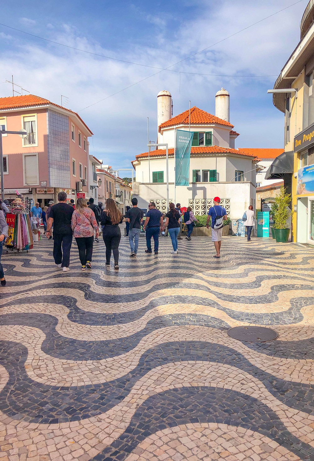 Beautiful patterned tiled floors in Old Town city center Cascais Portugal. Explore more on girl travel fashion blog xoxojho.