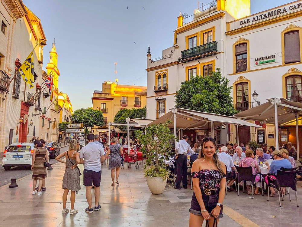 Photograph of girl travel blogger in historic center of Sevilla Spain. Vibrant city travel blog.
