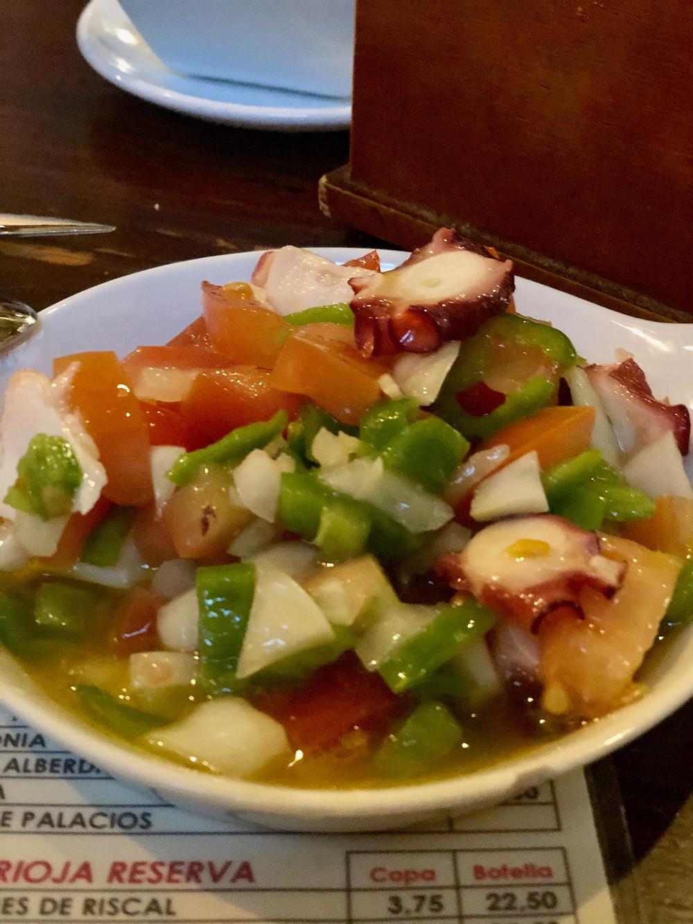 Photograph of delicious foodie travel blog octopus pulpo salad in sevilla spain tapas bar las teresa.
