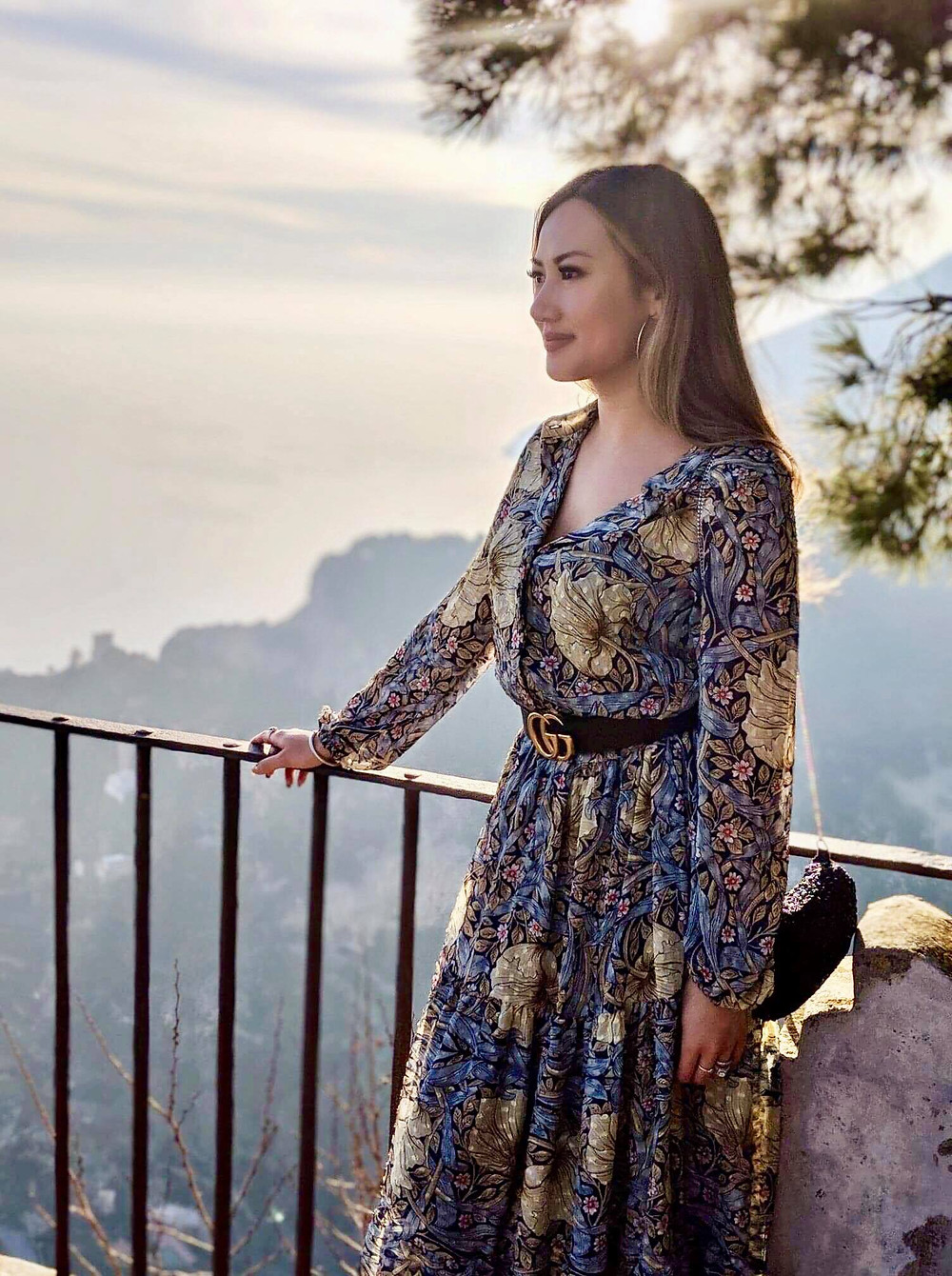 photograph of asian girl travel fashion blogger in ravello amalfi coast italy europe enchanted castle beautiful garden