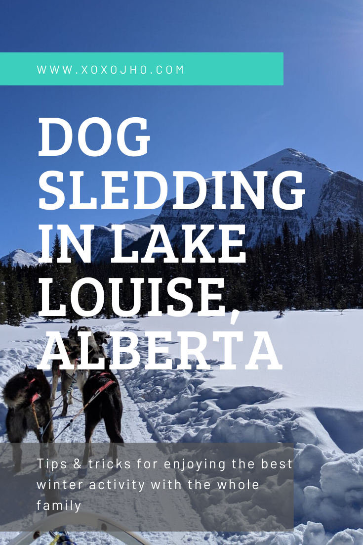 Photograph of girl travel blogger in Canada Rocky Mountains Lake Louise dog sledding