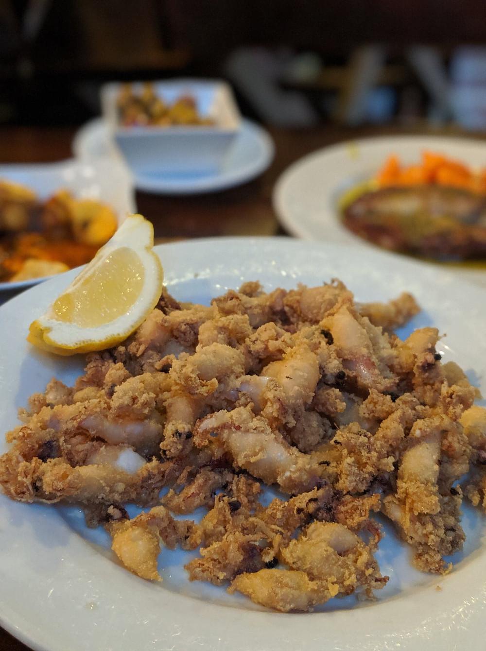sevilla spain tapas bar las teresa. calamari. girl travel blog