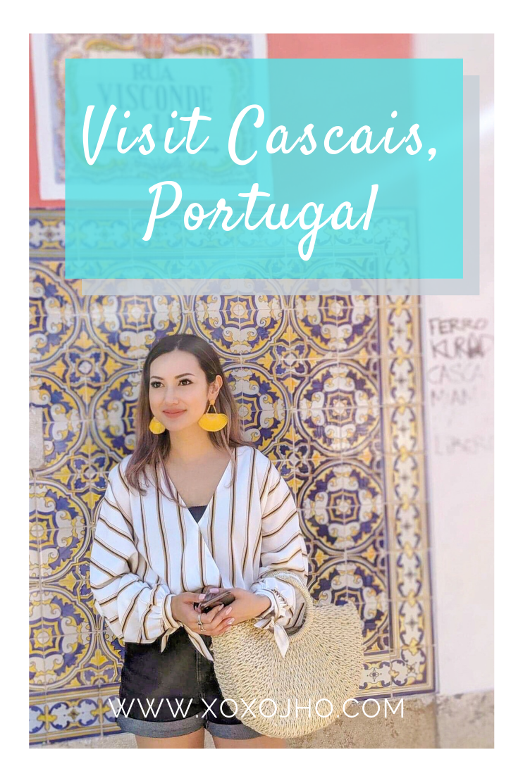 Must do activities in beautiful cascais portugal. downtown girl travel fashion blogger in fun outfit and earrings.