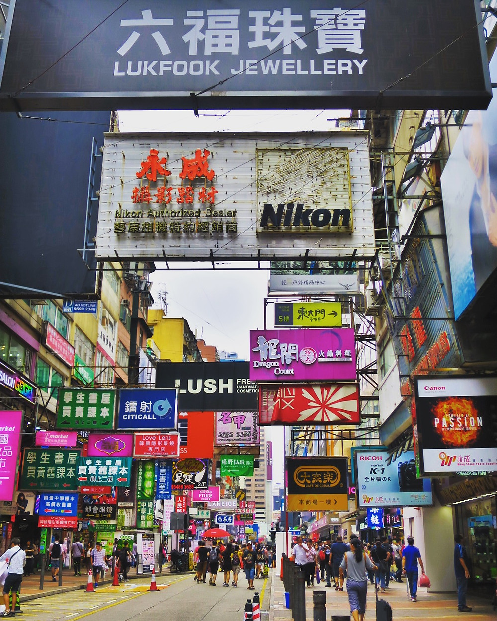 Ctyscape of Mong Kok shopping area with thousands of colorful neon signs in Hong Kong. Travel blog read about Asia xoxojho