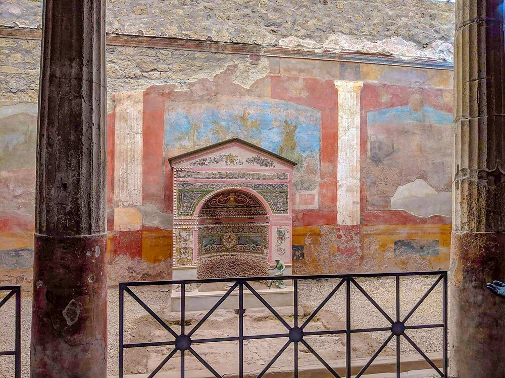 photograph of beautiful mosaic ancient roman fountain in pompeii italy europe