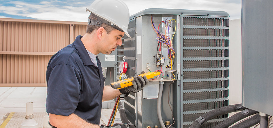 Trained hvac technician holding a voltag