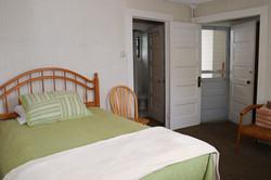 E main room towards bedroom and front door