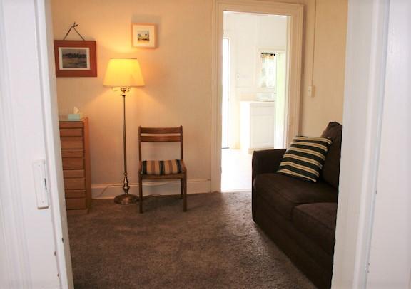 5 living room towards kitchen and front door