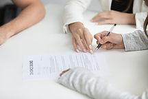 wife-signing-divorce-decree-after-break-up-decision-min.jpg