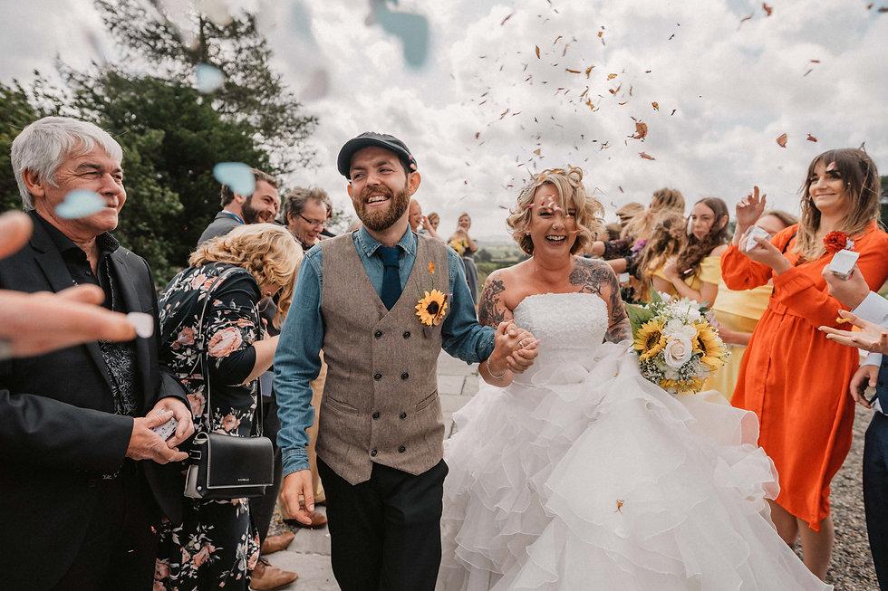bride and groom confetti shot _ love