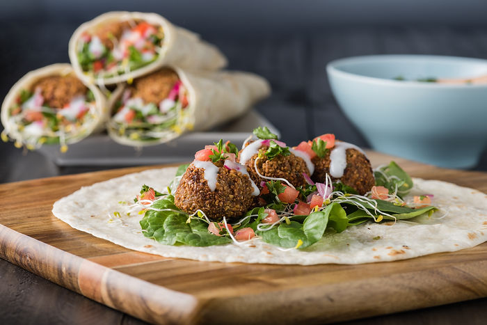 Vegan Falafel Wrap With Salsa and salad.