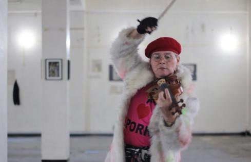 Sarah Jane Baker plays the violin.