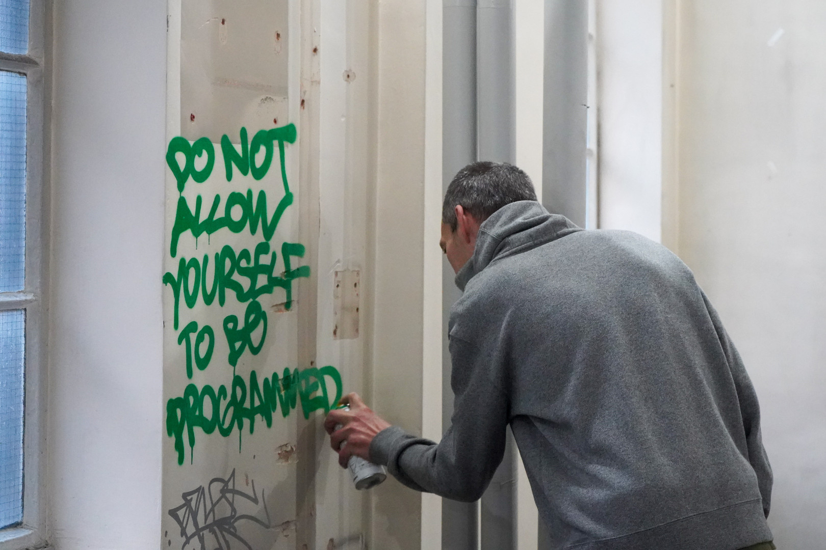 A visitor gets involved with some unplanned participatory graffiti