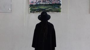 A guest oberves Eva Joy's work