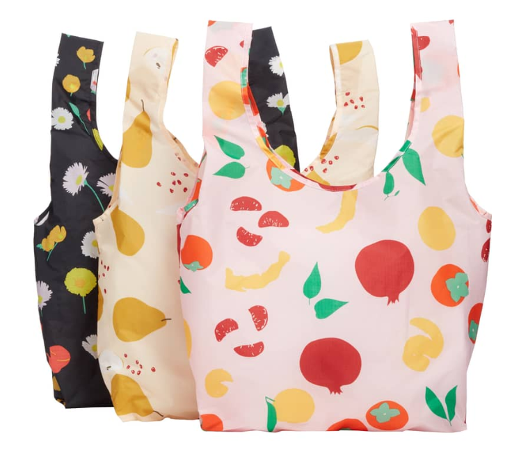 Fordable nylon making perfect to keep in your purse for when you only went in to get one item and end up needing a bag. Love these happy prints. These bags really fit a lot.