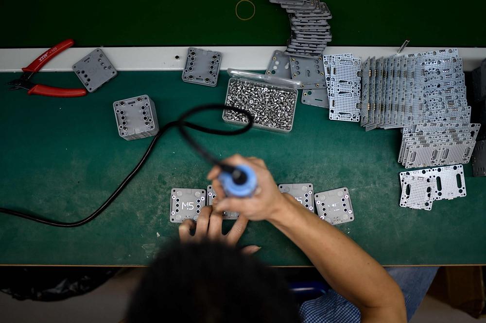trabajador manufactura china produccion eeuu dinero importacion