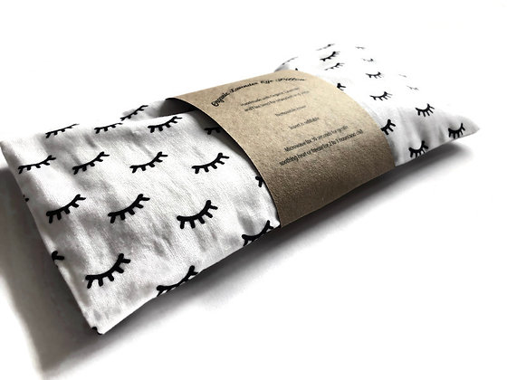 lavender eye pillow with sleepy eyes
