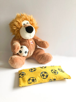 Lavender eye pillow with footballs and teddy holding football